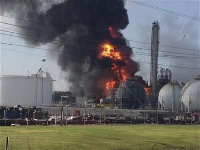 A large fire burns at the Williams Olefins chemical plant in Geismar, Louisiana in this picture taken June 13, 2013.  REUTERS/Picture courtesy of Ryan Meador/Handout via Reuters