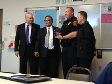 Gateway Association recognizes Sheboygan Police with flag and plaque.
