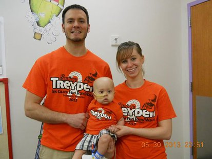 Travis, Treyden, and Cassie Kurtzweil