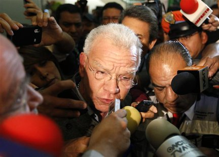 Andres Granier (C), former governor of Tabasco state, speaks to the media upon his arrival at the international airport in Mexico City June