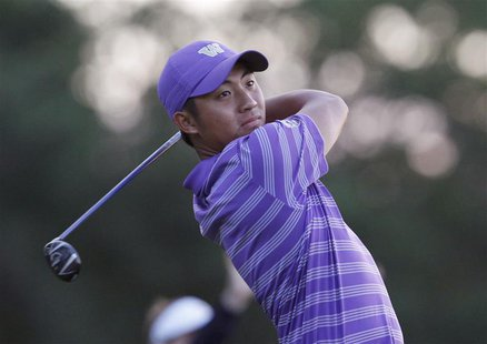 Amateur Cheng-Tsung Pan of Taiwan tees off on the ninth hole during the second round of the 2013 U.S. Open golf championship at the Merion G