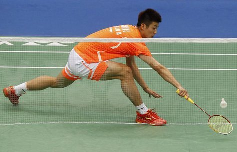 China's Chen Long plays against China's Du Pengyu (not pictured) during their men's singles finals of the Badminton Asia Championships in Ta