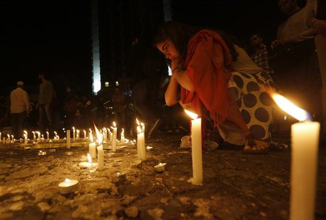 Protesters light candles in memory of victims of the recent violent anti-government protests in Turkey in Istanbul's Taksim square June 14,
