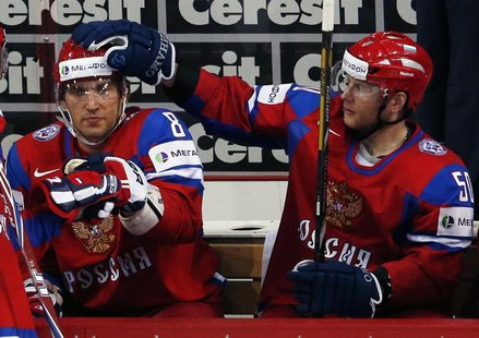 Russia's Alexander Ovechkin (L) gets a pat on the head by teammate Sergei Soin after judges validated his goal against Team USA during their