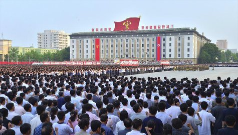 People attend a mass rally at Kim Il Sung Square in Pyongyang, in this photo released by North Korea's Korean Central News Agency (KCNA) on
