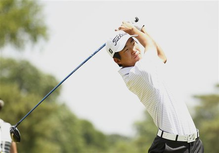 Amateur Michael Kim of the U.S. tees off on the second hole during the third round of the 2013 U.S. Open golf championship at the Merion Gol