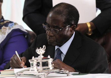 Zimbabwe President Robert Mugabe signs Zimbabwe's new constitution into law in the capital Harare, replacing a 33-year-old document forged i
