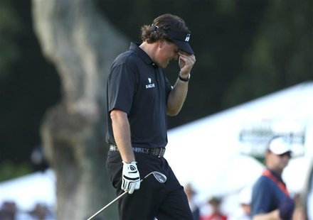 Phil Mickelson of the U.S. walks to the 18th green during the final round of the 2013 U.S. Open golf championship at the Merion Golf Club in