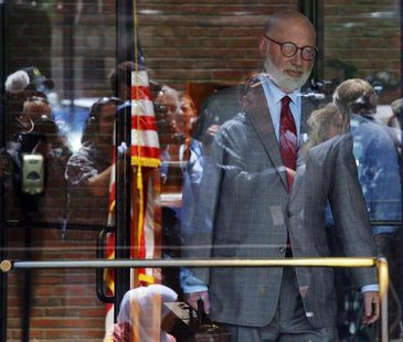 "Reporters and television cameras are reflected in the glass doors as J.W. Carney, defense attorney for accused mob boss James ""Whitey"" Bulge"