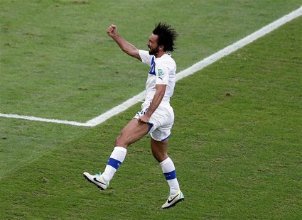 Italy's Andrea Pirlo celebrates after scoring against Mexico during their Confederations Cup Group A soccer match at the Estadio Maracana in