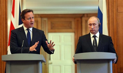 Britain's Prime Minister David Cameron (L) and Russia's President Vladimir Putin hold a joint news conference in 10 Downing Street, central