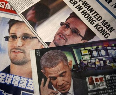Photos of Edward Snowden, a contractor at the National Security Agency (NSA), and U.S. President Barack Obama are printed on the front pages