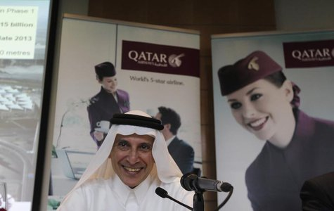 Chief Executive of Qatar Airways Akbar Al Baker laughs during the Arabian Travel Market at Dubai International Convention and Exhibition Cen