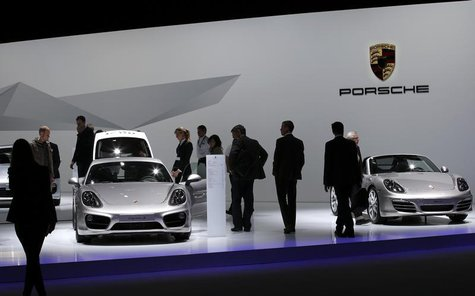 Shareholders watch Porsche cars during the annual shareholders meeting of Porsche in Leipzig, April 30, 2013. REUTERS/Fabrizio Bensch