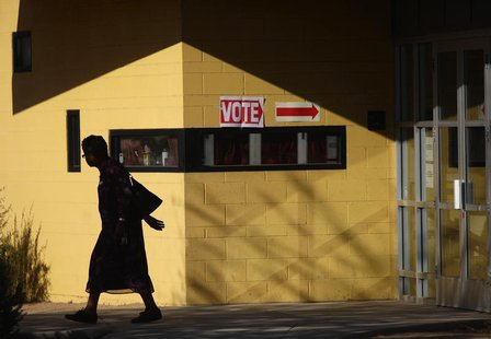 A voter leaves polling station outside Hayden Park during the U.S. presidential election in Phoenix, Arizona November 6, 2012. REUTERS/Joshu