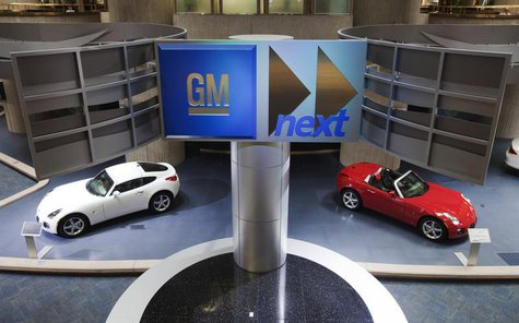 Cars are seen on display inside the General Motors Corp world headquarters in downtown in Detroit, May 28, 2009. REUTERS/Mark Blinch
