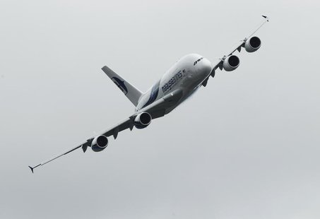 An Airbus A380 performs a display flight at the Farnborough Airshow 2012 in southern England July 9, 2012. REUTERS/Luke MacGregor
