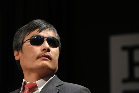 Chinese dissident Chen Guangcheng speaks to journalists following an appearance in New York in this May 3, 2013 file photo. REUTERS/Brendan