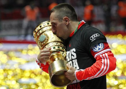 Bayern Munich's Franck Ribery kisses the trophy as he celebrates their victory over VfB Stuttgart in their German soccer cup (DFB Pokal) fin