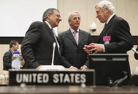 U.S. Secretary of Defense Leon Panetta (L) speaks with U.S. Ambassador to the North Atlantic Treaty Organization Ivo Daalder (C) and Europea