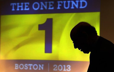 "Ken Feinberg, administrator for ""The One Fund, Boston"" talks to a Boston Marathon bombing survivor before a town hall style meeting about th"