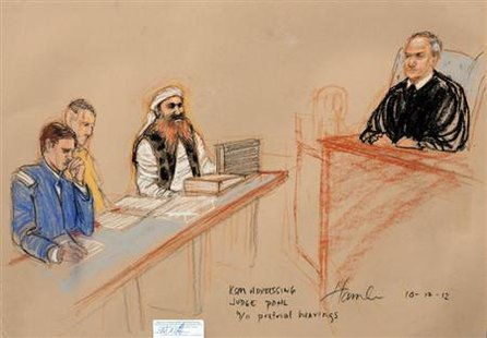 Khalid Sheikh Mohammed, (2nd R) the alleged mastermind of the September 11 attacks, addresses the judge during the third day of pre-trial hearings in the 9/11 war crimes prosecution as depicted in this Pentagon-approved courtroom sketch at the U.S. Naval Base Guantanamo Bay, Cuba, October 17, 2012. Credit: Reuters/Janet Hamlin