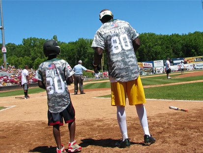 Donald Driver and his son on Father's Day 2013 in Appleton at his charity softball game (WTAQ News Photo).
