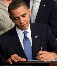 Barack Obama signing the Patient Protection and Affordable Care Act at the White House