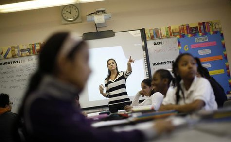 Teacher Jaclyn Kruljac speaks to her students in 5th grade class at Walsh Elementary School in Chicago, Illinois, March 1, 2013. REUTERS/Jim