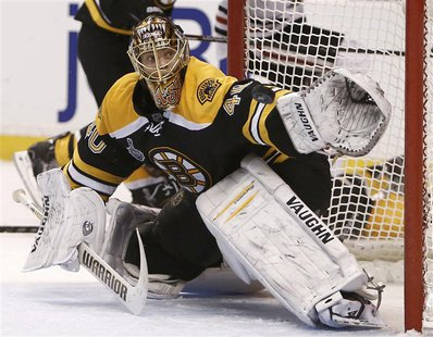 Boston Bruins goalie Tuukka Rask makes a glove save in the third period against the Chicago Blackhawks in Game 3 of their NHL Stanley Cup Fi