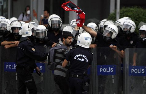 Riot police detain a demonstrator during protests at Kizilay square in central Ankara, June 16, 2013. REUTERS/Dado Ruvic (TURKEY - Tags: POL
