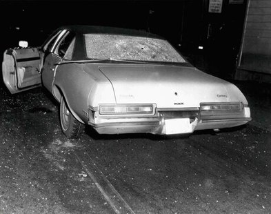 A vehicle with bullet holes and broken glass which was shown to jurors hearing the racketeering and murder trial of accused Boston mob boss
