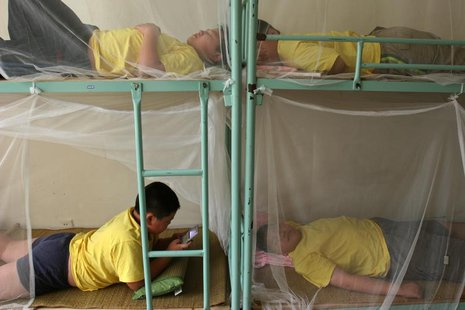 Children rest during a weight-losing summer camp organized by a slimming centre in Wuhan, central China's province July 13, 2006. CHINA OUT