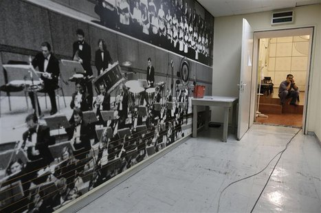 An employee is seen inside a music studio in the Greek state television ERT headquarters at Aghia Paraskevi suburb in Athens June 18, 2013.