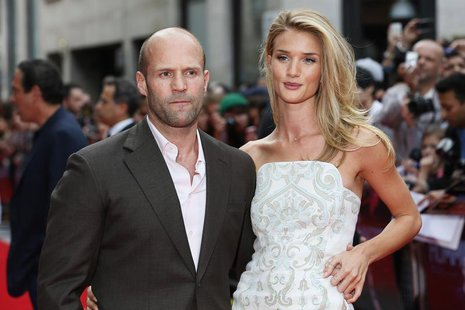 "Actor Jason Statham arrives with his girlfriend Rosie Huntington-Whiteley for the world premiere of ""Hummingbird"", at Leicester Square in ce"