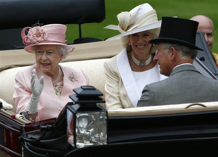 Britain's Queen Elizabeth (L), Prince Charles and Camilla Duchess of Cornwall arrive by carriage for the first day of the Royal Ascot horser