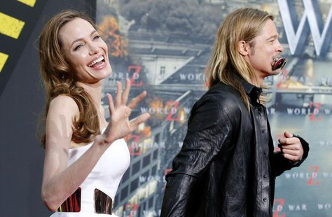 Cast member Brad Pitt and his fiance Angelina Jolie arrive for the premiere of the film World War Z in Berlin June 4, 2013. REUTERS/Tobias S