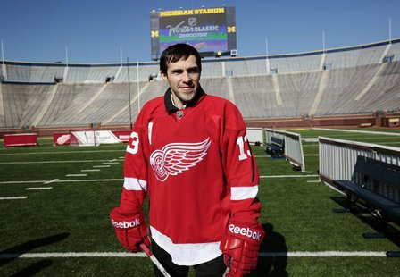 Detroit Red Wings player Pavel Datsyuk stands on the field at Michigan Stadium in Ann Arbor, Michigan February 9, 2012, following an announc