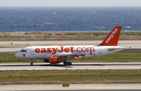 An Easyjet airliner lands for the opening of a new base of the low cost airline at Nice International airport March 21, 2012. REUTERS/Eric G