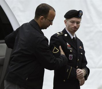 U.S. Army Private First Class Bradley Manning (R) enters the courtroom for day four of his court martial at Fort Meade, Maryland June 10, 20