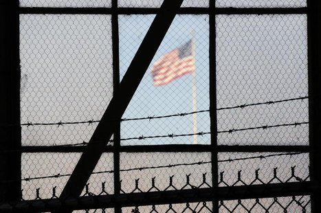 The flag over a war crimes courtroom in Camp Justice at US Naval Base Guantanamo Bay in Cuba in this photo reviewed by the U.S. Department o