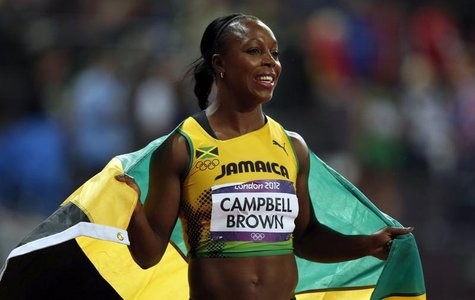 Jamaica's Veronica Campbell-Brown celebrates after finishing third the women's 100m final during the London 2012 Olympic Games at the Olympi