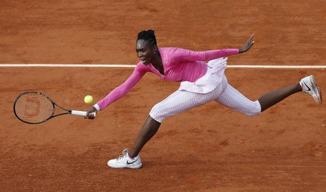 Venus Williams of the U.S. hits a return to Urszula Radwanska of Poland during their women's singles match at the French Open tennis tournam