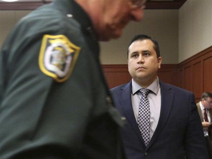 George Zimmerman stands as the judge leaves the courtroom as jury selection continues in his second-degree murder trial in Sanford, Florida,