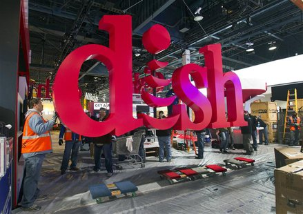 Workers build a booth for Dish, a satellite TV provider, as they prepare for the International CES show at the Las Vegas Convention Center i