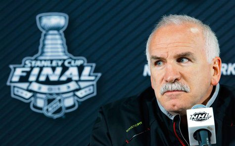 Chicago Blackhawks head coach Joel Quenneville listens to a question from a reporter in Boston, Massachusetts, June 18, 2013 ahead of Game 4