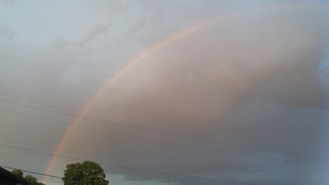 Kalamazoo Rainbow spans the west side as sunshine penetrates the rain.