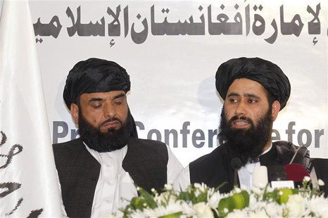 Muhammad Naeem (R), a spokesman for the Office of the Taliban of Afghanistan speaks during the opening of the Taliban Afghanistan Political