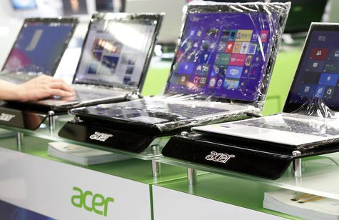 Acer laptops are displayed in a computer mall in Taipei March 19, 2013. REUTERS/Pichi Chuang