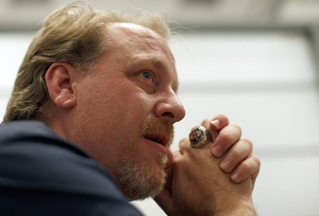 Former MLB player Curt Schilling talks with a reporter at the Electronic Entertainment Expo, or E3, in Los Angeles, California June 9, 2011.